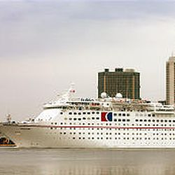 The Carnival Holiday sails along the Mobile River in Mobile, Ala. The ship will transform Mobile into a port city.