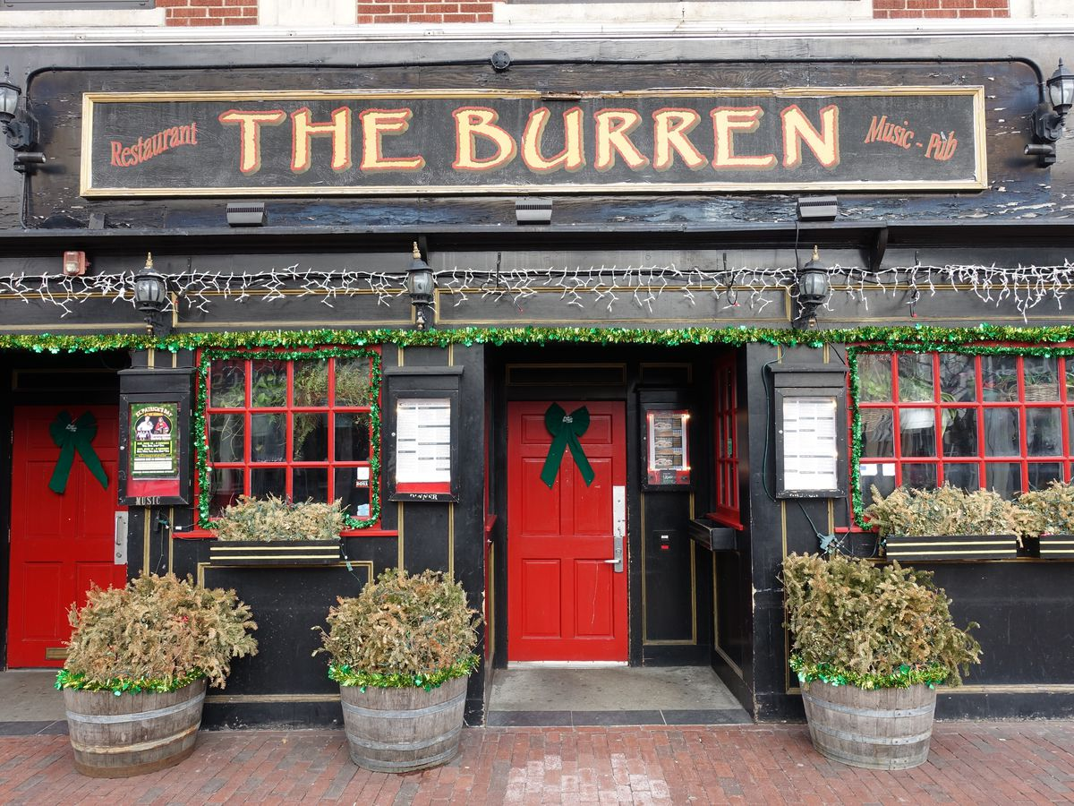 The exterior of the Burren in Somerville's Davis Square, painted black with bright red doors and window frames