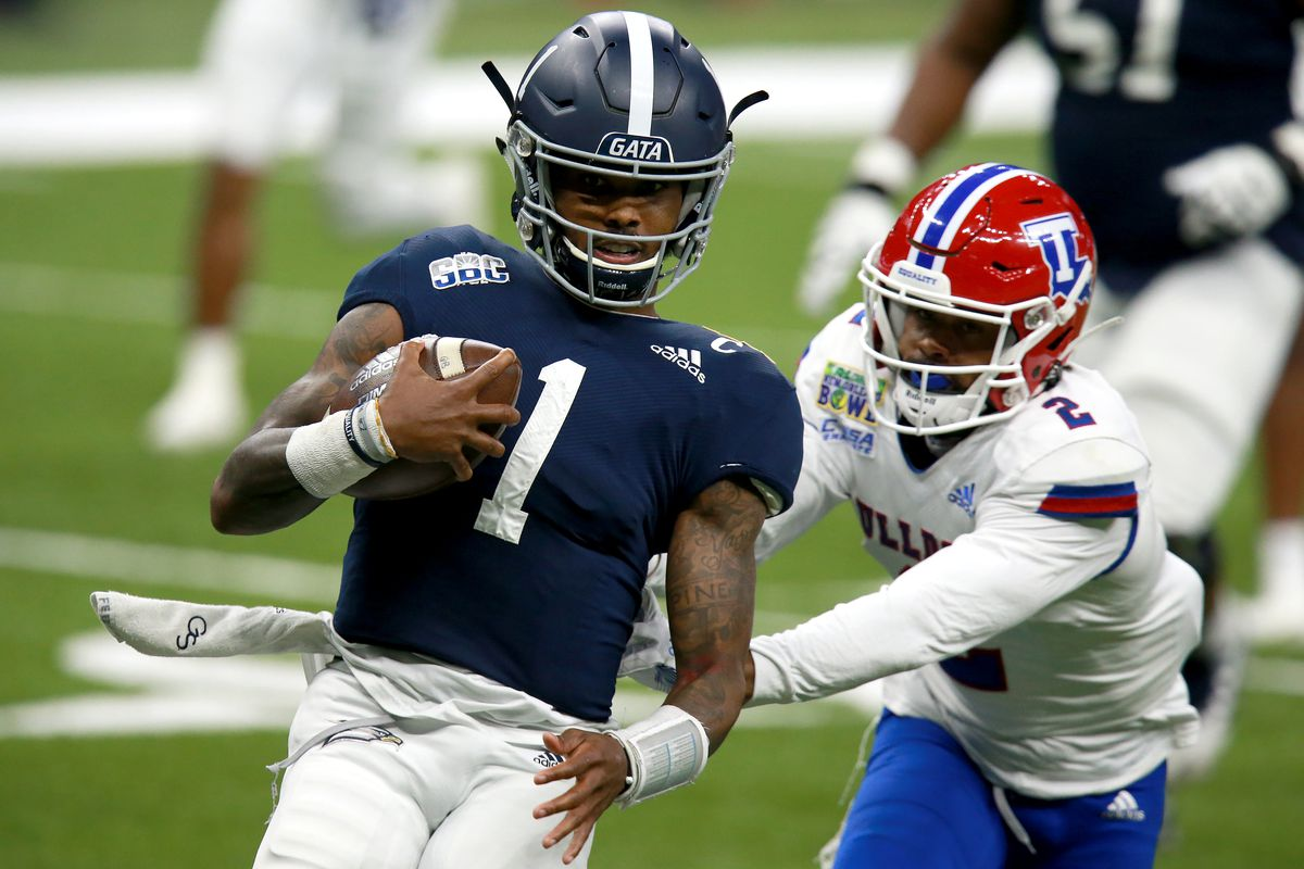 Shai Werts of the Georgia Southern Eagles runs for a touchdown past Zach Hannibal of the Louisiana Tech Bulldogs during the R&L Carriers New Orleans Bowl at Mercedes Benz Superdome on December 23, 2020 in New Orleans, Louisiana.
