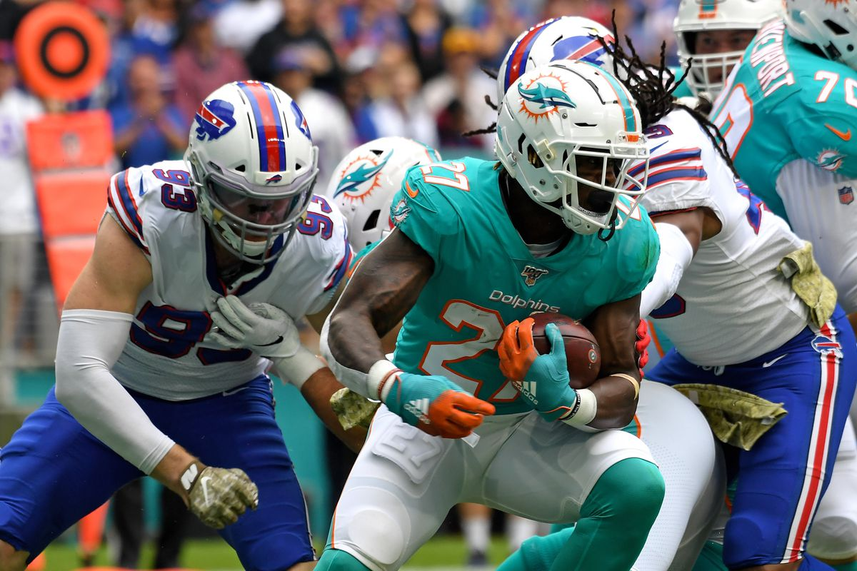 Miami Dolphins running back Kalen Ballage is tackled by Buffalo Bills defensive end Trent Murphy during the first half at Hard Rock Stadium.