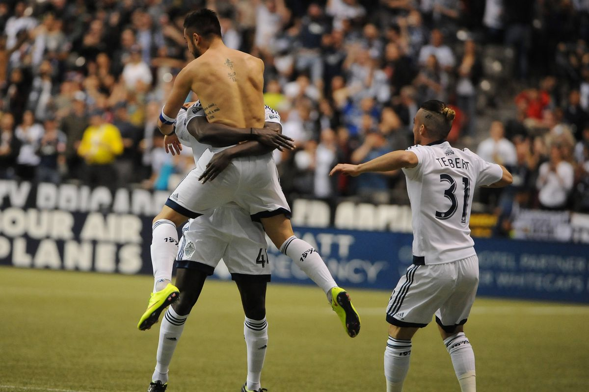 """Shirts off if you love the Caps! Pedro Morales' (shirtless) goal celebration earned him a yellow card for """"excessive"""" celebration."""