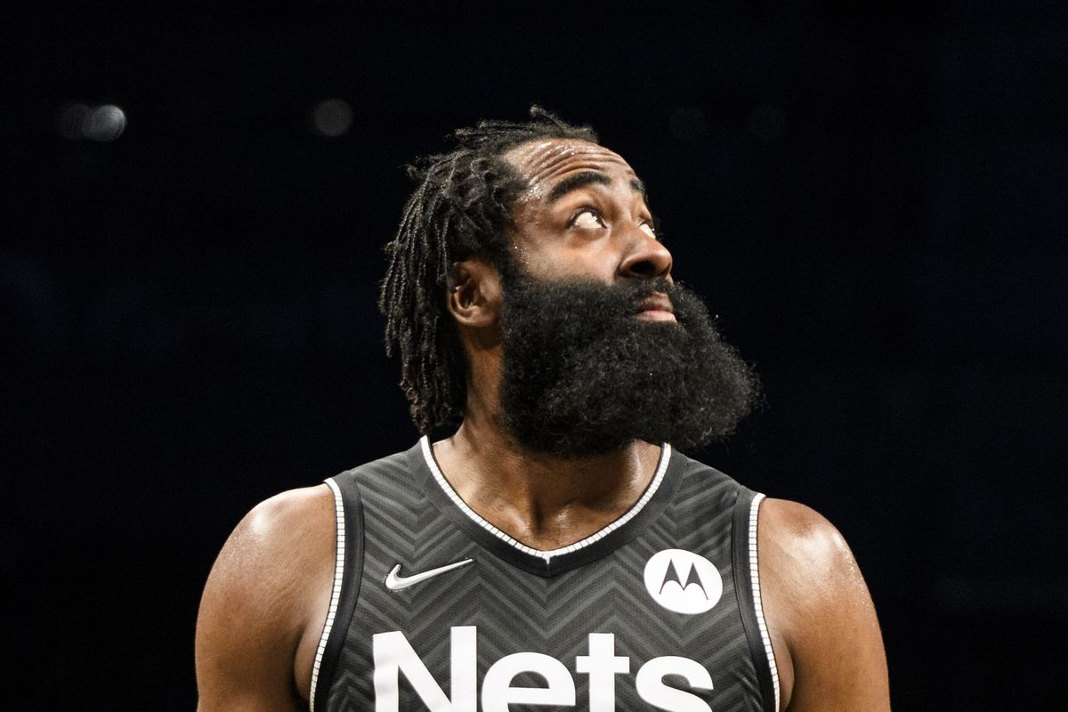 James Harden #13 of the Brooklyn Nets looks up at the video board during the game against the Boston Celtics on March 11, 2021 at Barclays Center in Brooklyn, New York.