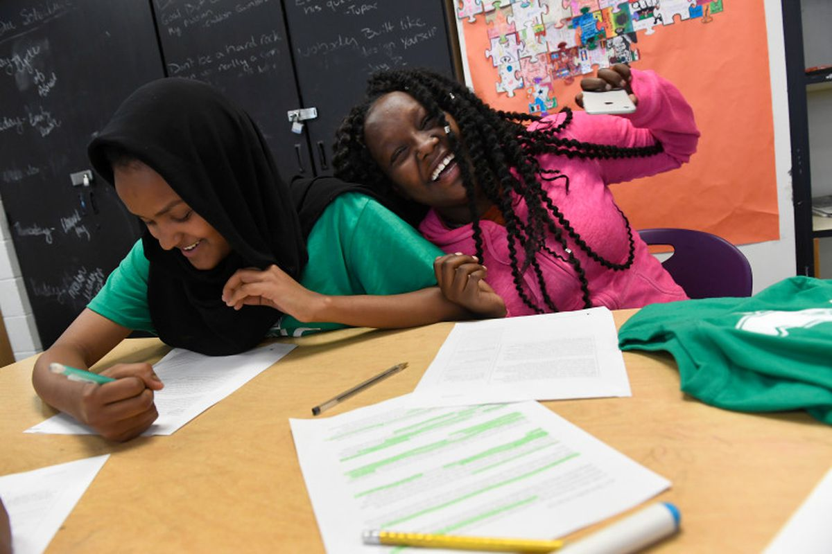 Mary Getachew, 15, right, laughs with her peer mentor Sabrin Mohamed, 18, left, at Denver's North High School in 2016.