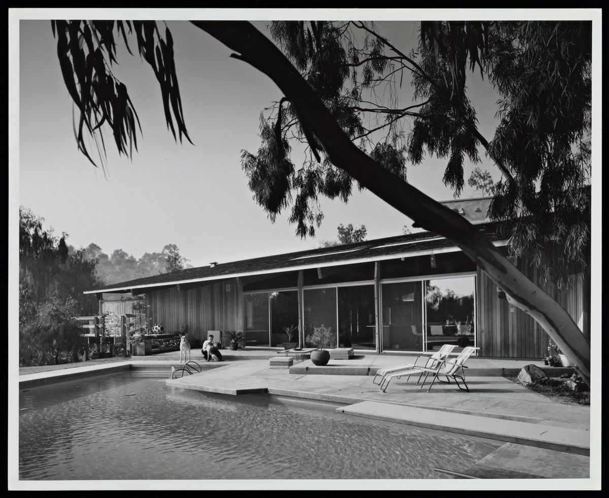 Black and white photo showing the pool and deck.