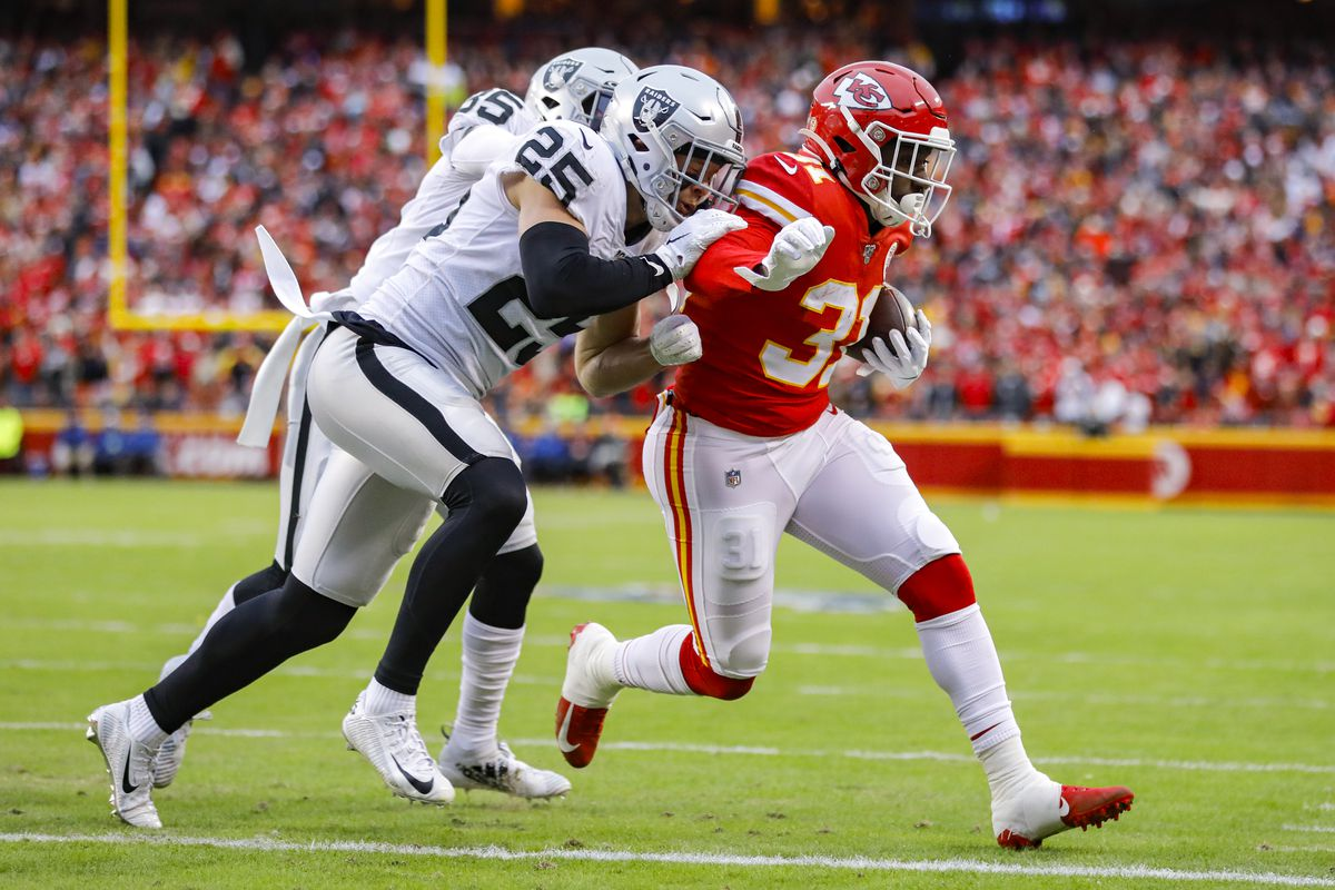 Darrel Williams of the Kansas City Chiefs beats the tackle of Erik Harris of the Oakland Raiders for a first quarter touchdown reception at Arrowhead Stadium on December 1, 2019 in Kansas City, Missouri.