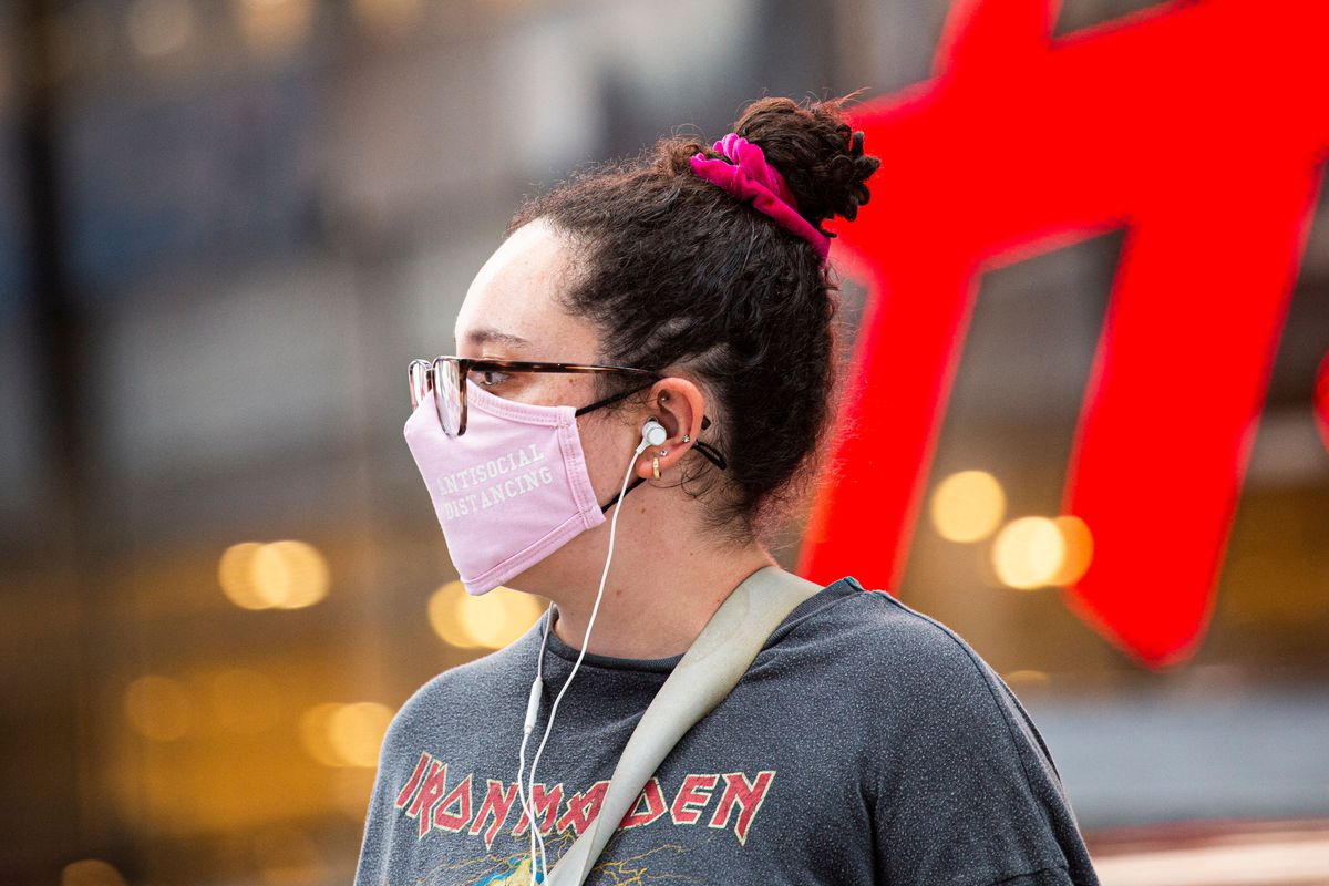 A woman wears a face mask in Midtown Manhattan in New York City on July 29, 2021.