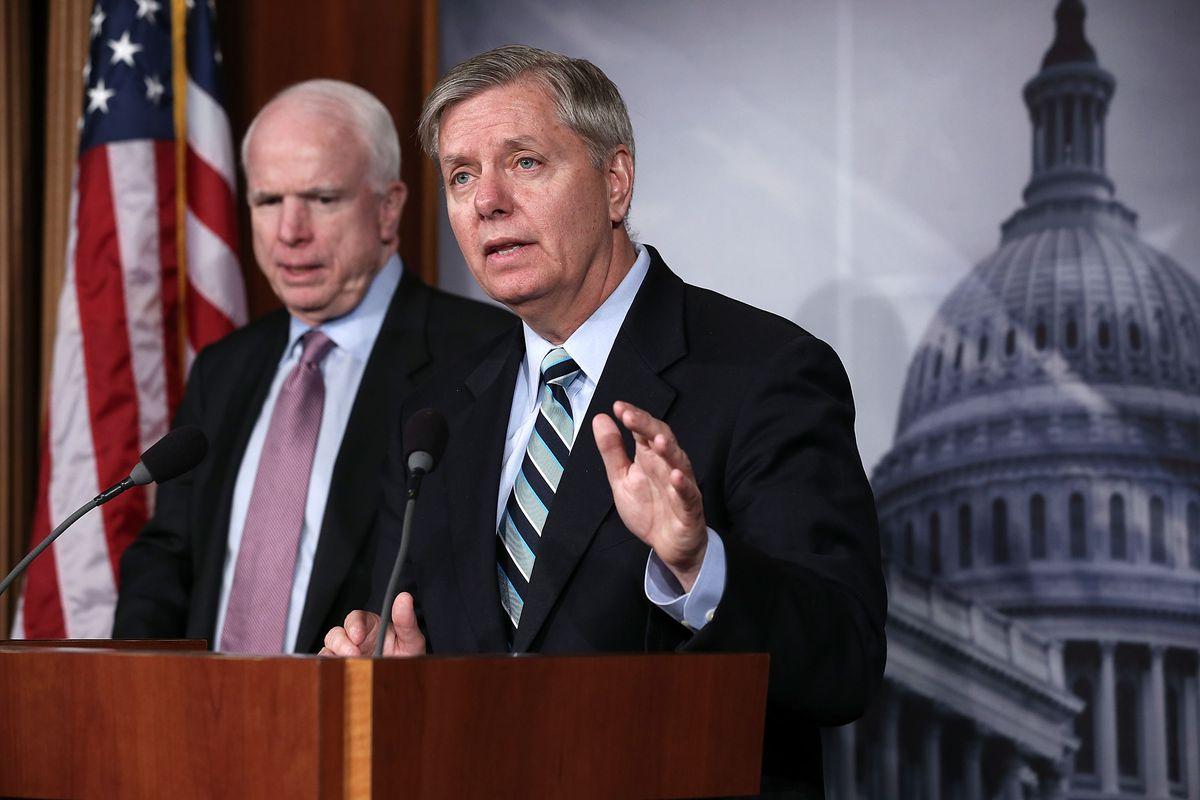 Lindsey Graham (right) and John McCain (left).