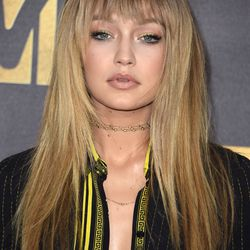 """BEST POSSIBLY FAKE BANGS: Gigi Hadid's hair stylist, Bryce Scarlett, is known for giving her fake 'dos, so we'll have to wait and see if it's real. Makeup artist Sarah Tanno gave her a """"metallic green smoked eye."""""""