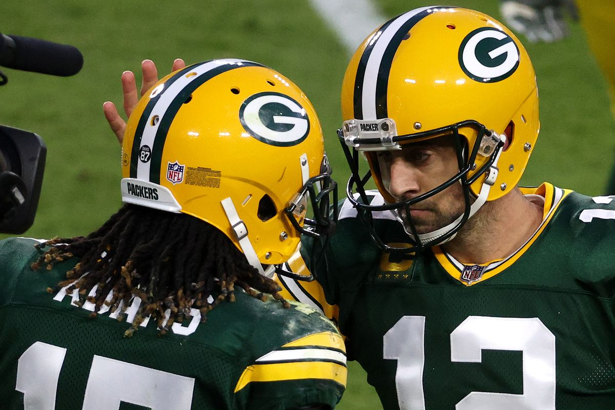 Aaron Rodgers of the Green Bay Packers celebrates with teammate Davante Adams following their touchdown completion during the first quarter of their game against the Philadelphia Eagles at Lambeau Field on December 06, 2020 in Green Bay, Wisconsin.