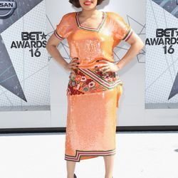 Andra Day in a vintage dress and Moschino heels