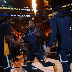 Utah Jazz guard Donovan Mitchell (45) enters the court before the game against the Cleveland Cavaliers at Vivint Smart Home Arena in Salt Lake City on Saturday, Dec. 30, 2017.