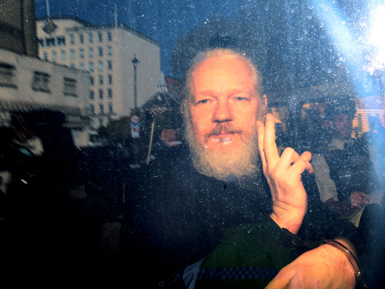 WiiLeaks founder Julian Assange gestures to the media upon arriving at a London court in April 2019 following his arrest.