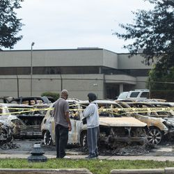 Burnt cars, which were set on fire following the shooting of Jacob Blake by a police officer in Kenosha Sunday, are seen in this photo Tuesday afternoon, Aug. 25, 2020.