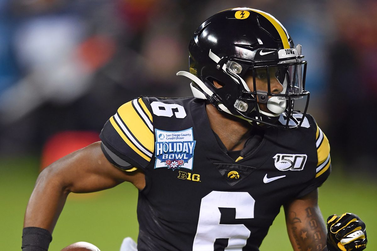 Iowa Hawkeyes wide receiver Ihmir Smith-Marsette returns the opening kickoff during the 2019 Holiday Bowl game played on December 27, 2019 against the USC Trojans at SDCCU Stadium in San Diego, CA.