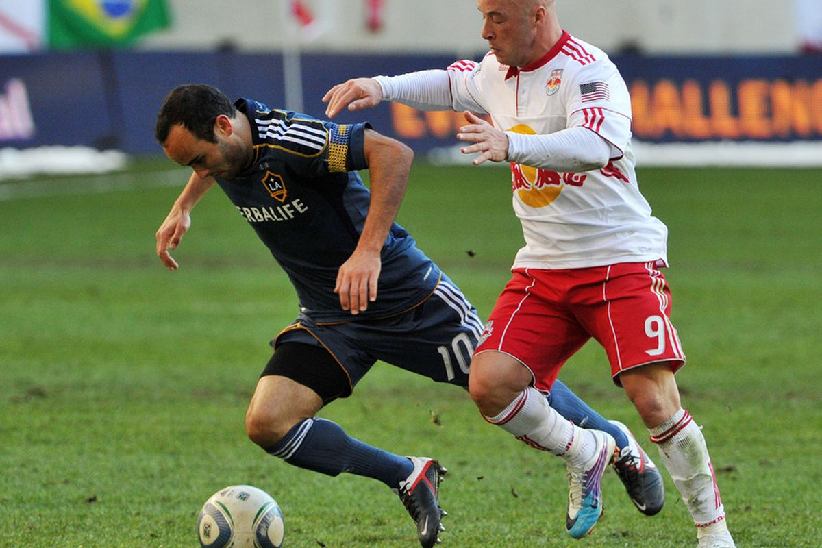 HARRISON, NJ - OCTOBER 30: Who's that guy behind Landon Donovan? (Photo by Christopher Pasatieri/Getty Images)