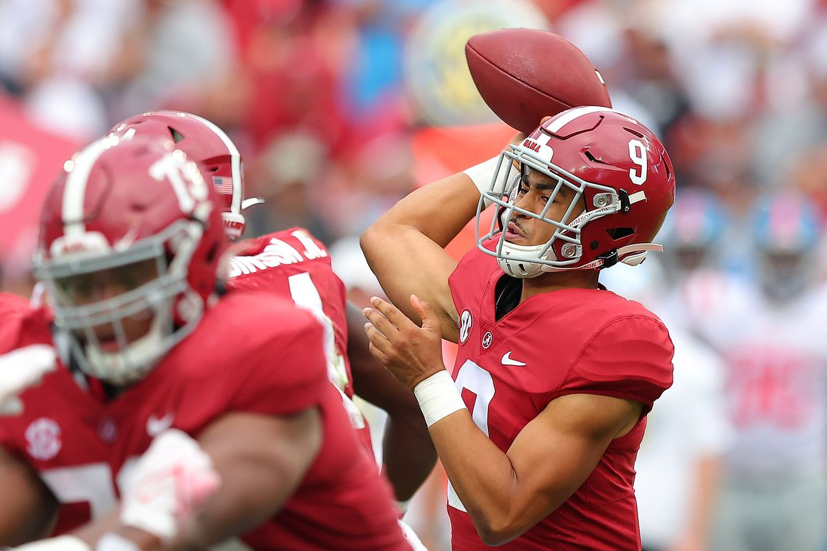 Bryce Young of the Alabama Crimson Tide looks to pass against the Mississippi Rebels during the second half at Bryant-Denny Stadium on October 02, 2021 in Tuscaloosa, Alabama.