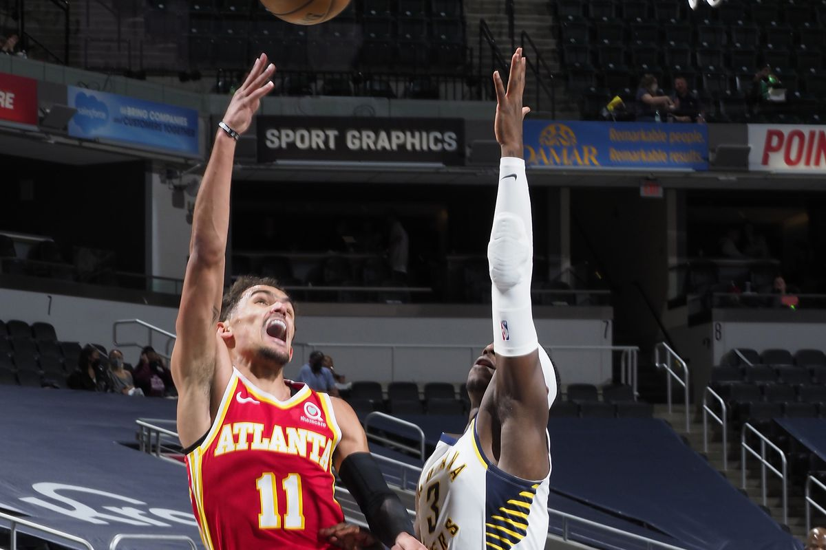 Trae Young #11 of the Atlanta Hawks drives to the basket during the game against the Indiana Pacers on May 6, 2021 at Bankers Life Fieldhouse in Indianapolis, Indiana.