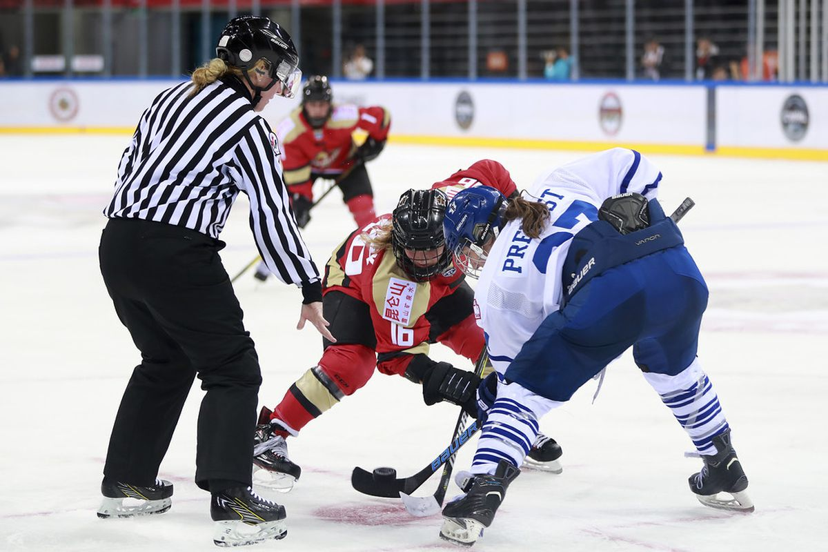 Toronto Furies forward Carolyne Prevost leans in for a faceoff against Kunlun Red Star's Kelli Stack