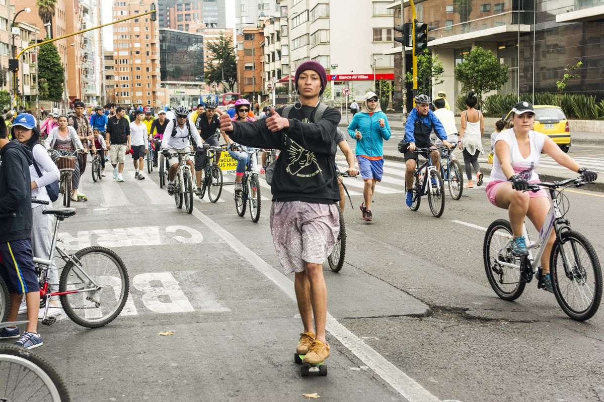 Joggers, cyclists, and skateboarders enjoy the streets of Bogota, Colombia, during Ciclovía, a weekly event when cars are blocked off for recreation.
