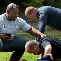 Ron Williams, a nondenominational Christian pastor, leads an exercise group of Utah National Guard members at their headquarters in Draper on Thursday, Aug. 14, 2014.