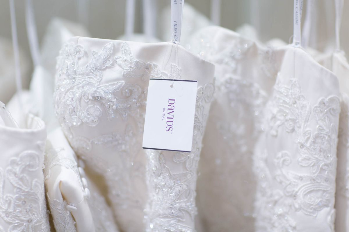 Davids bridal doesnt want to be the walmart of weddings anymore the knot says that the average cost of a wedding dress in 2014 was 1357 but the median cost was certainly markedly lower ombrellifo Image collections