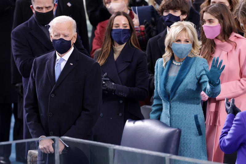 Joe Biden and Jill Biden stand at the inauguration ceremony.