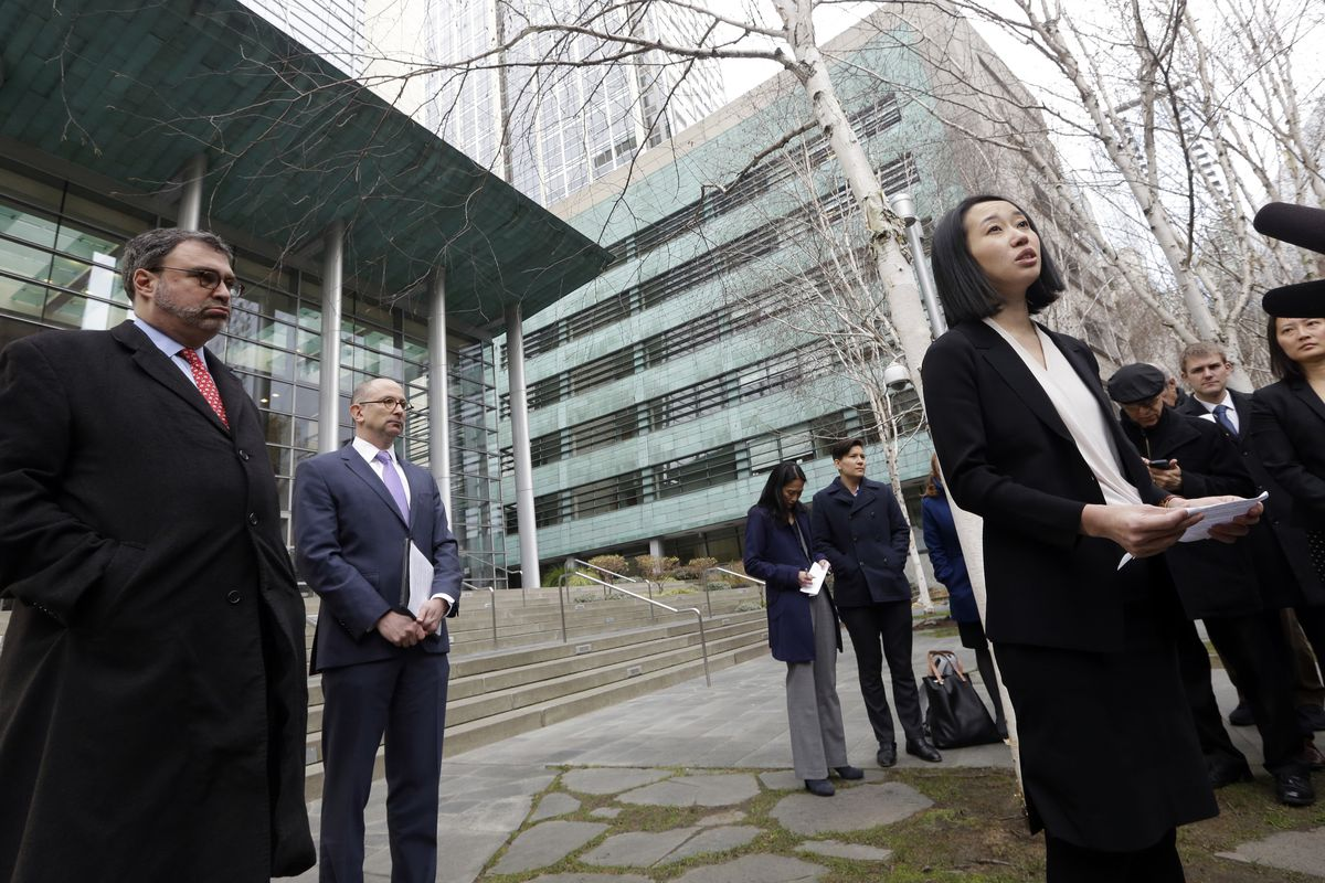 FILE - In this Thursday, Dec. 21, 2017 file photo, Mariko Hirose, right, a litigation director at the Urban Justice Center, speaks to reporters accompanied by Mark Hetfield, president & CEO of HIAS, left, and Rabbi Will Berkowitz, Jewish Family Service of