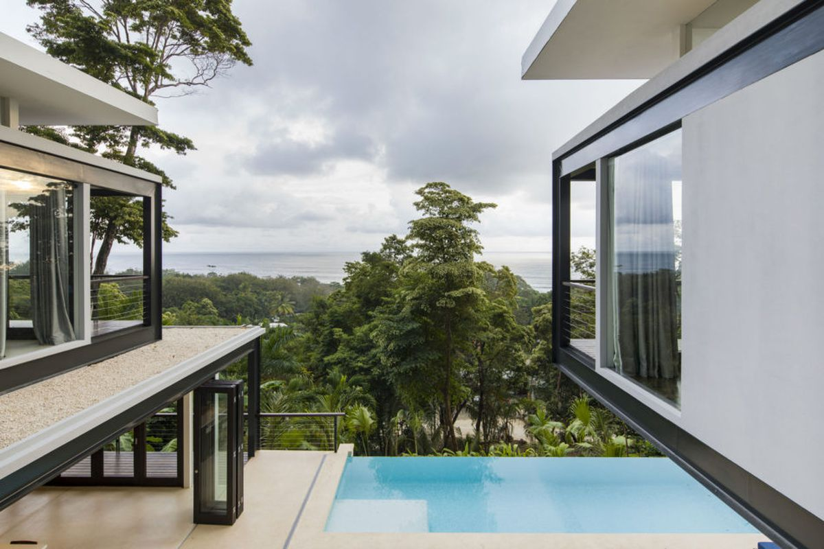 Shot from home looking out onto infinity pool and ocean beyond.