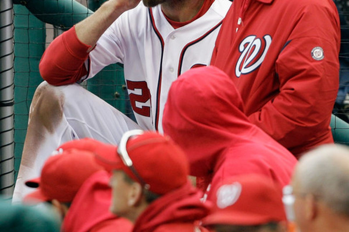 WASHINGTON, DC - MARCH 31: Jayson Werth #28 of the Washington Nationals sits in the dugout during the fifth inning against the Atlanta Braves at Nationals Park on March 31, 2011 in Washington, DC.  (Photo by Rob Carr/Getty Images)