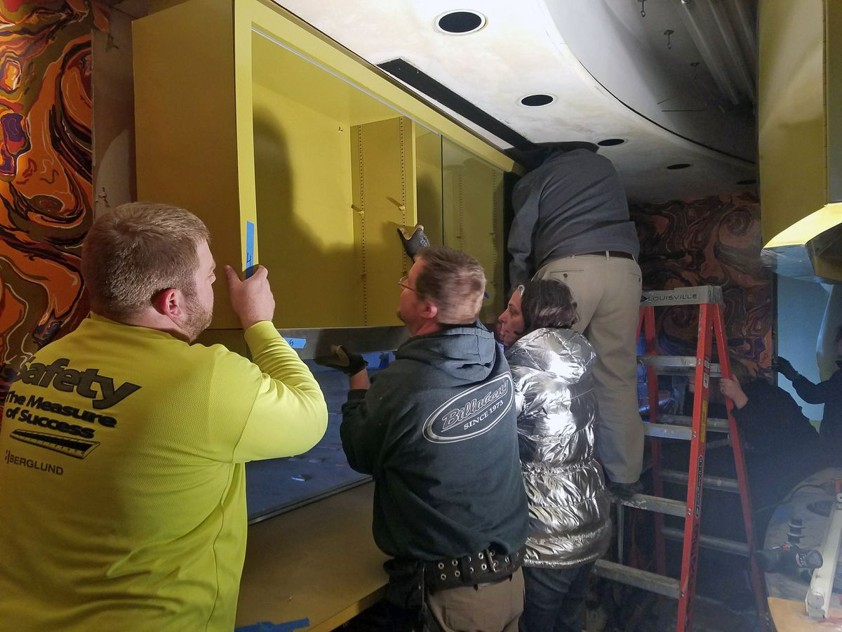 Volunteers remove cabinets from the Ebony test kitchen.