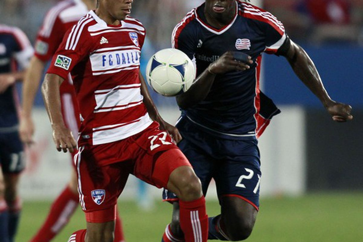 Apr 5, 2012; Frisco, TX, USA; FC Dallas defender Carlos Rodriguez (22) fights for the ball with New England Revolution midfielder Sharlrie Joseph (21) during the first half at FC Dallas Stadium. Mandatory Credit: Tim Heitman-US PRESSWIRE