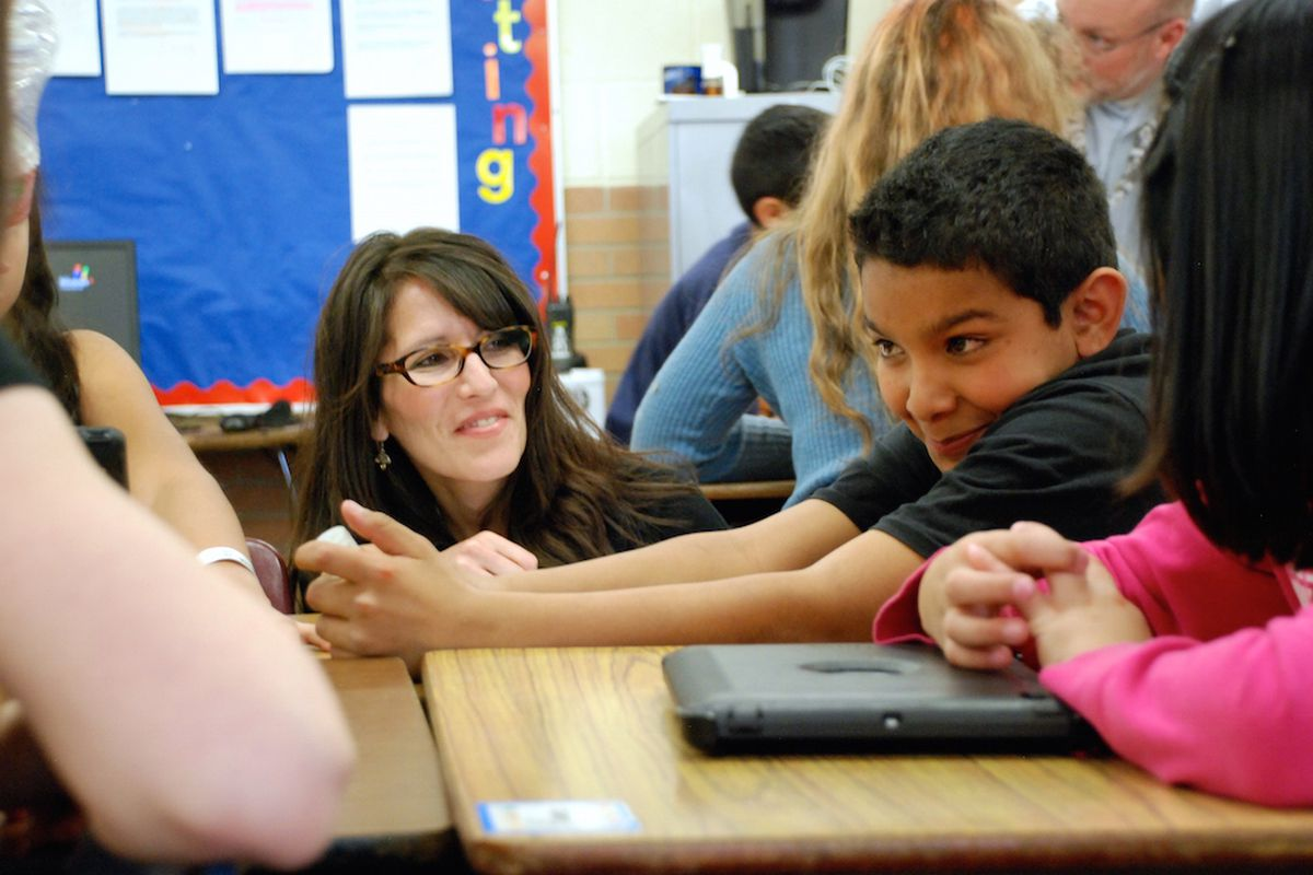 Lumberg Elementary School principal Rhonda Hatch-Rivera visits with students Thursday. She hopes a proposed overhaul of schools, including hers, yields more social and emotional support for students.