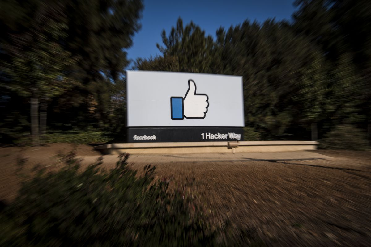 """Signage of a """"like"""" thumbs-up is displayed outside Facebook's headquarters in Menlo Park, California, in 2018"""