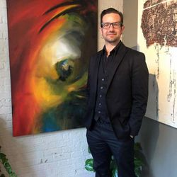 """Artist Chauncey Secrist stands in front of an abstract painting he created titled """"Cyndi."""""""