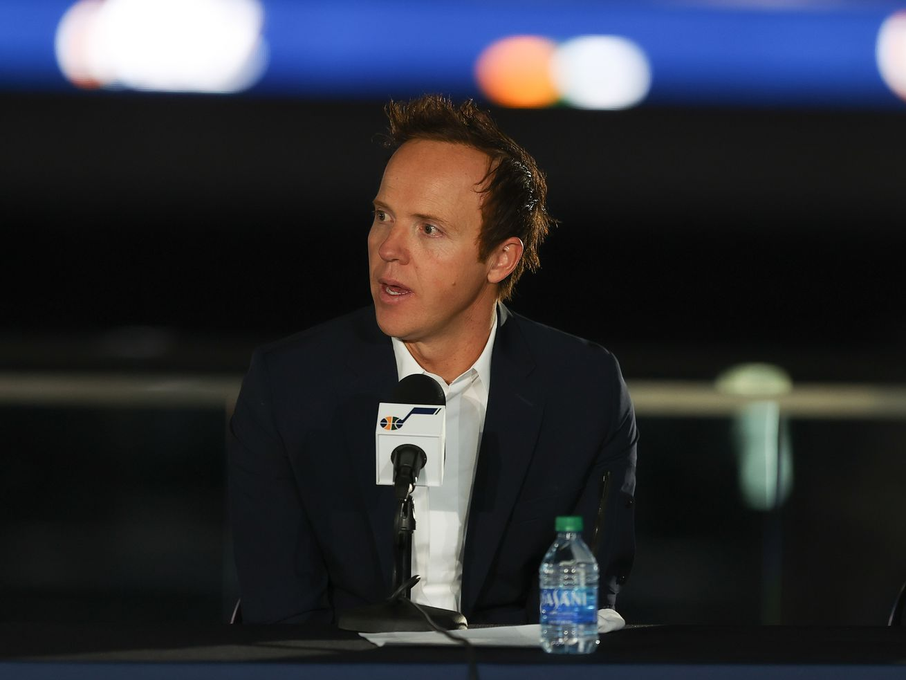 Ryan Smith, CEO of Qualtrics, speaks at a press conference announcing Smith's purchase of the Utah Jazz from Gail Miller.