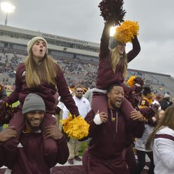 CMU cheerleaders sing along to the fight song during post-game victory celebrations.