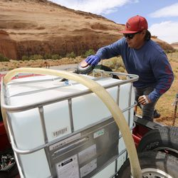 Will Yazzie fills a 250-gallon water tank in Oljato-Monument Valley, San Juan County, on Thursday, April 30, 2020. Yazzie waited around 2 1/2 hours before it was his turn at the water pump. He waits in line and refills the tank roughy every two days to supply water to his household as well as horses and other animals. Roughly 30% of the population in theNavajo Nation lacks running water. TheNavajo Nation has one of the highest per capita COVID-19 infection rates in the country.