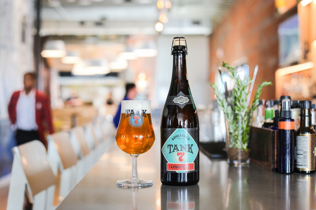 A bottle of Boulevard Brewing Co.'s Tank 7 and a filled beer tulip sit on a bar at Parlor restaurant in Kansas City.