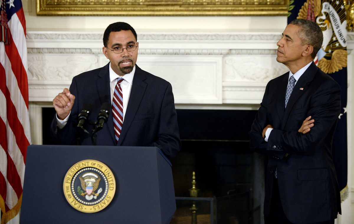 John King speaks as President Obama looks on during a 2015 event to announce that King would become the education secretary.