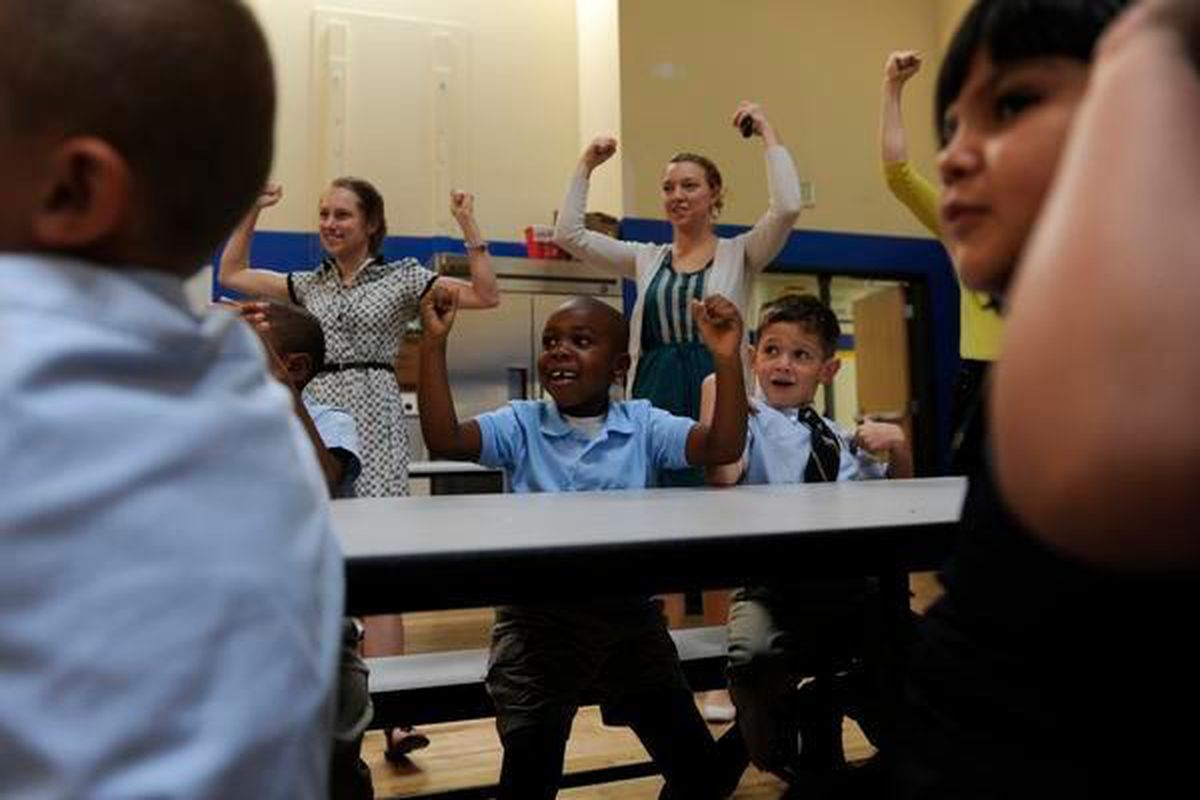 Students and staffers at Rocky Mountain Prep's first charter school in Denver cheer in 2012. (Photo by The Denver Post)
