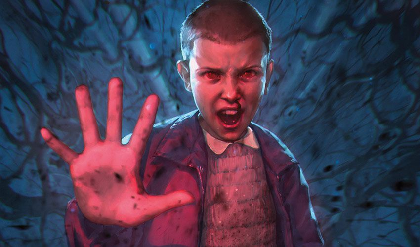 Eleven, in her season one outfit, uses her mind powers for ... something. There's black tendrils in the air.