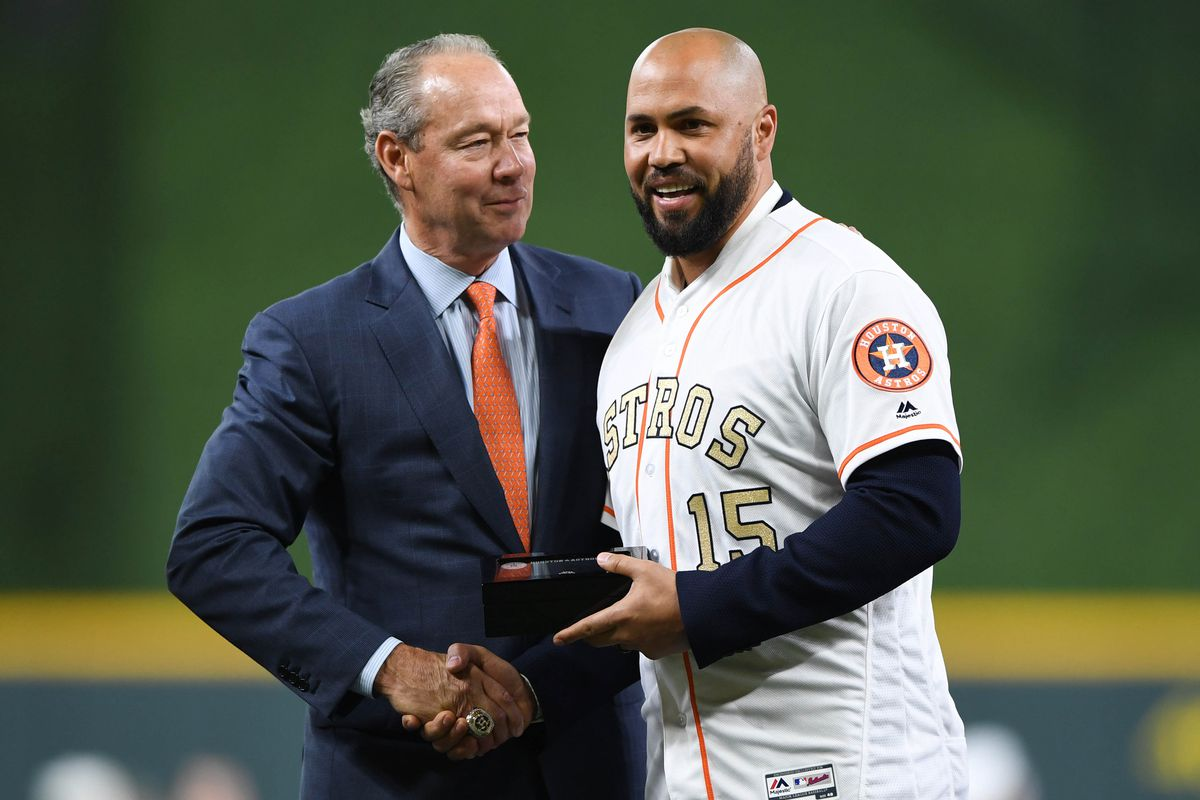 Houston Astros former player Carlos Beltran poses with owner Jim Crane as he receives his ring during the World Series ring ceremony at Minute Maid Park.