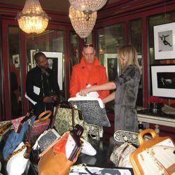 Dee shows Robert Verde her designs