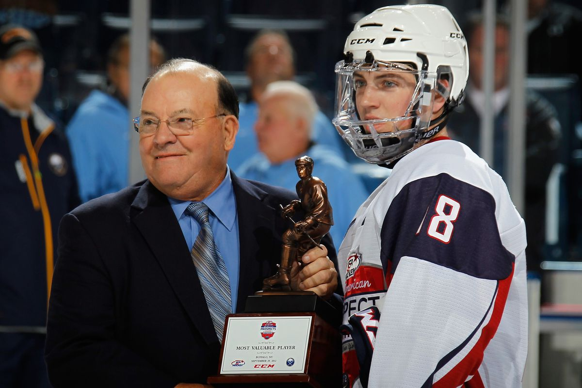 Ryan Fitzgerald accepts his MVP award from Scotty Bowman at the USA Hockey Prospects Camp.