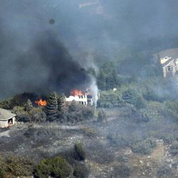 A home burns due to a wildfire at the mouth of Weber Canyon on Tuesday, Sept. 5, 2017.