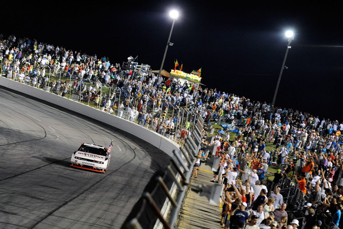 Brad Keselowski drives the No. 22 Discount Tire Dodge around the track in a victory lap after winning the NASCAR Nationwide Series Kroger 200 at Lucas Oil Raceway.