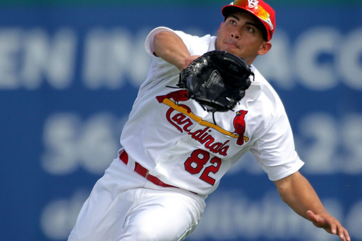 JUPITER, FL - MARCH 12: Outfielder Erik Komatsu #82 of the St Louis Cardinals makes a catch against the Atlanta Braves at Roger Dean Stadium on March 12, 2012 in Jupiter, Florida.  (Photo by Marc Serota/Getty Images)