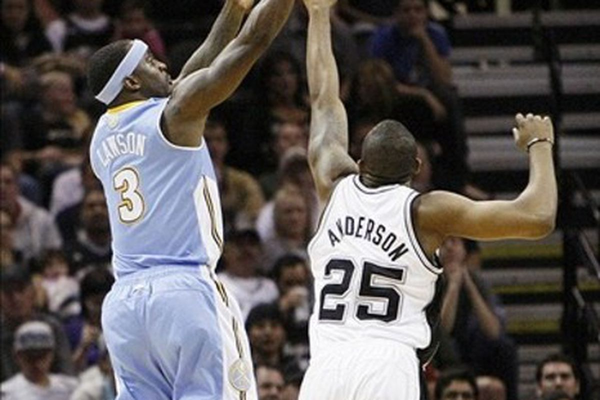 Mar 4, 2012; San Antonio, TX, USA; Denver Nuggets guard Ty Lawson (3) shoots against San Antonio Spurs guard James Anderson (25) during the first half at the AT&T Center. Mandatory Credit: Soobum Im-US PRESSWIRE
