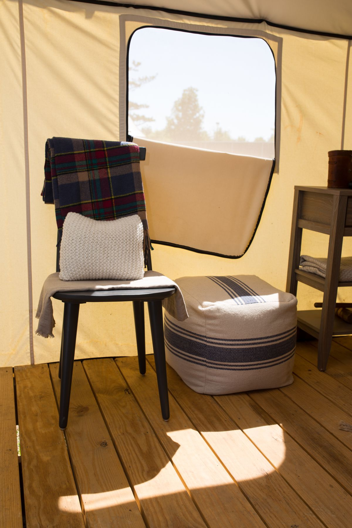 Chair and beanbag inside a glamping tent