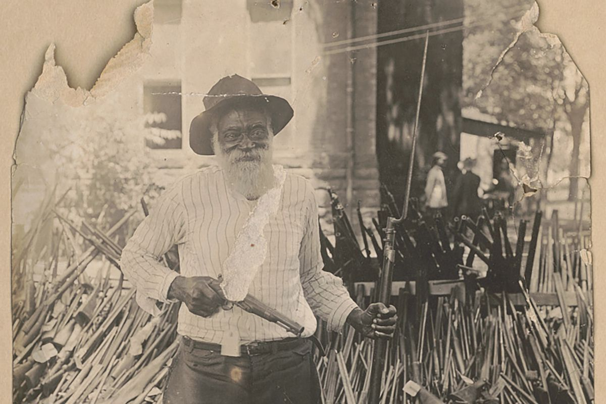 Daniel Hoskins with guns that had been deposited at Gregg County Courthouse, in Longview, Texas in 1919.